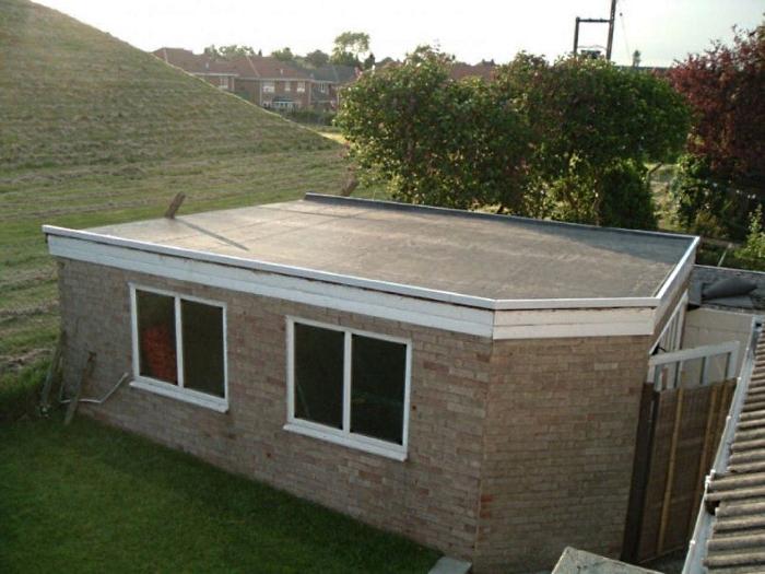 дачный домик с плоской крышей