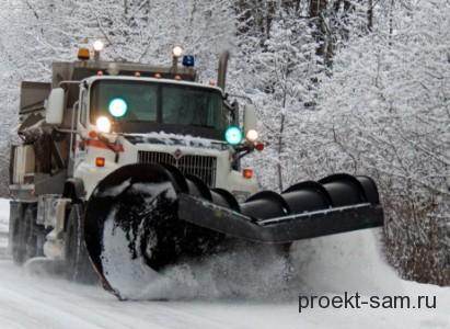 чистка снега трактором зимой