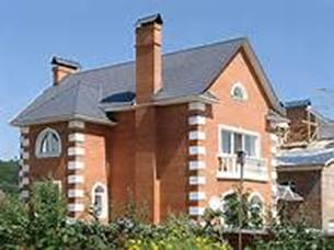 дом облицованный красным кирпичом