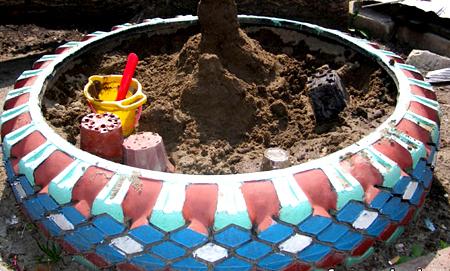 песочница из покрышки