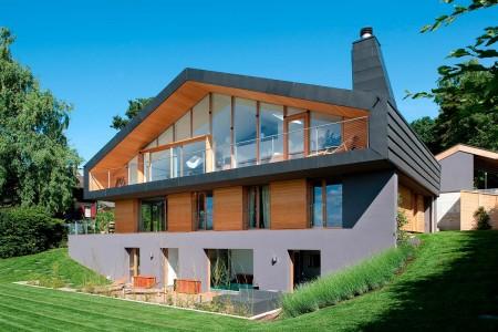 проект современного трехэтажного загородного дома с мансардой